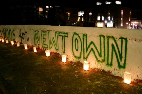 Newtown painting with luminarias lit up.