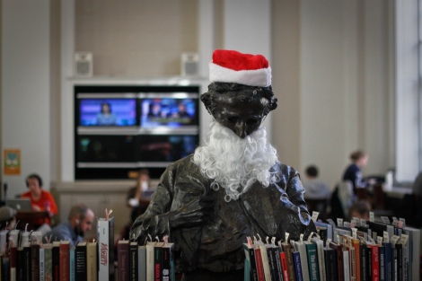 The Poe statue in Alderman Library getting festive.