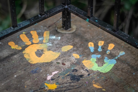 Colorful hand prints on the pavement
