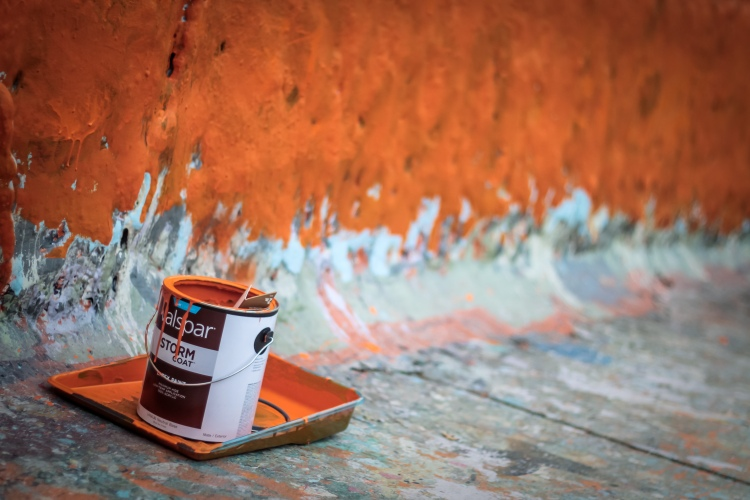 Orange paint bucket left on the west side